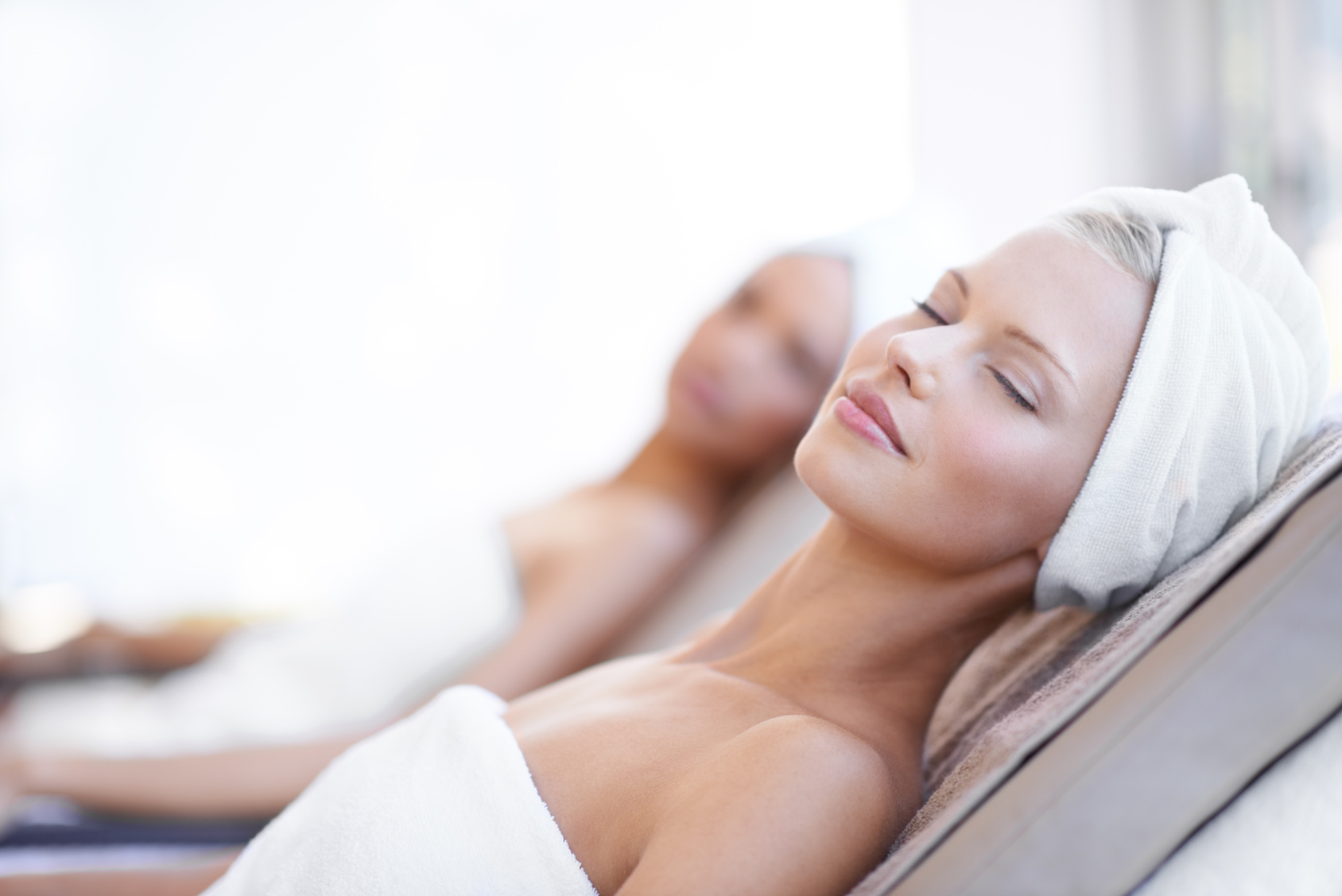 A beautiful young woman relaxing at the beauty spa